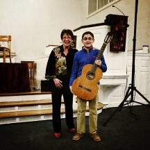 Myrna Sislen, Middle C Music, and the Guitar Raffle winner, Carlos Olivares, Beatty Competitor